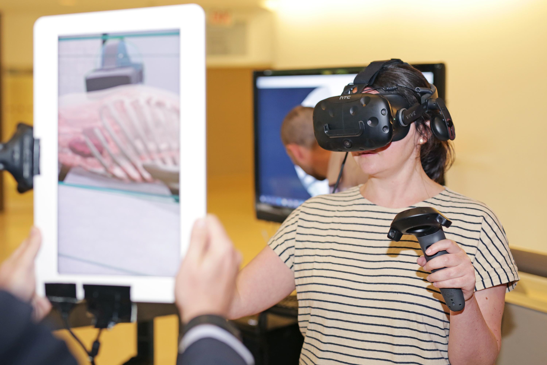 Laura Bertrand, Université de Lyon project officer uses the HTC Vive to explore a virtual cadavre.