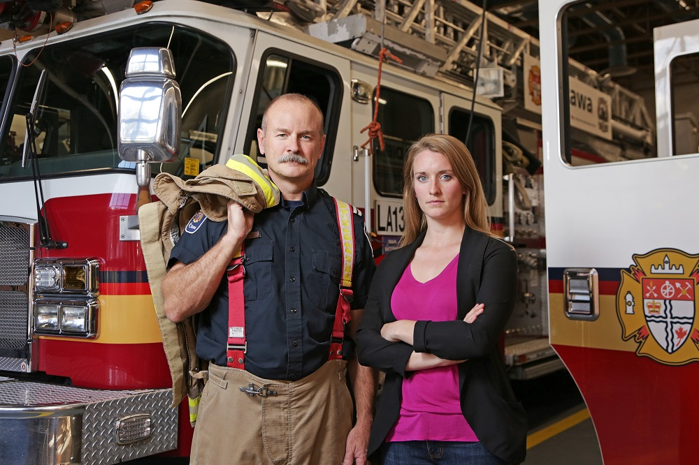 Captain David Matschke and researcher Jennifer Keir in an Ottawa fire station