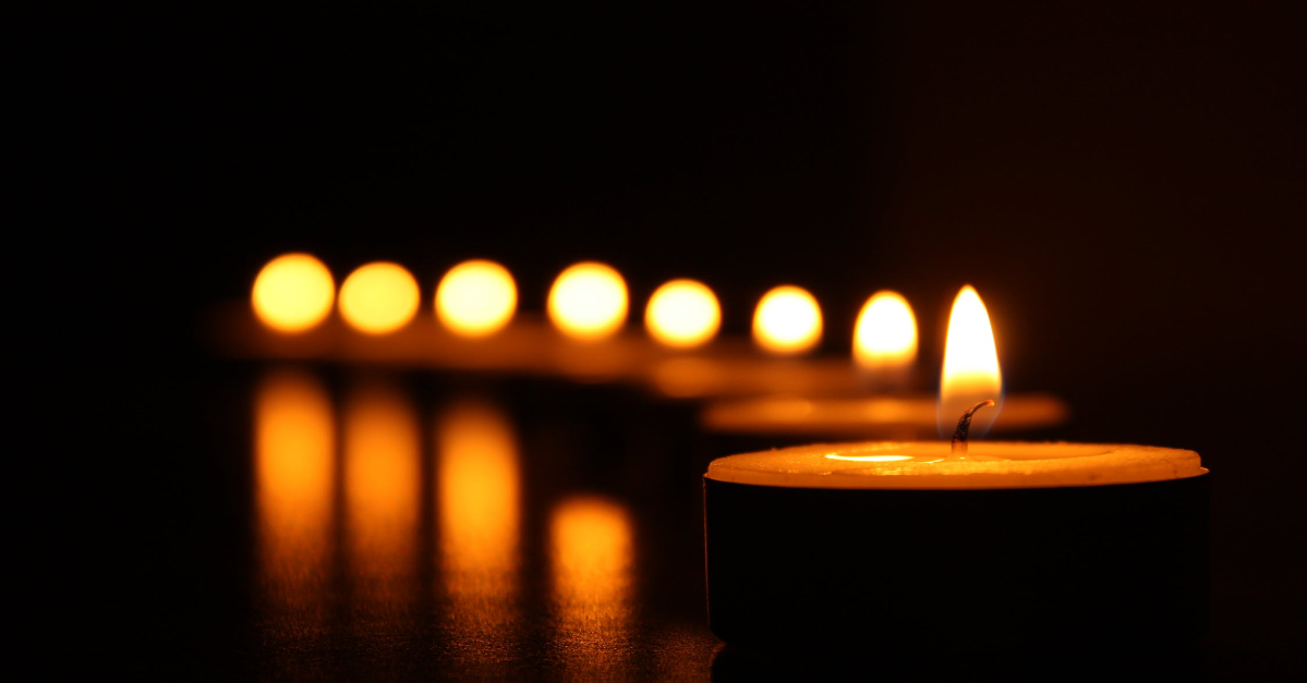Candles lit in the dark.
