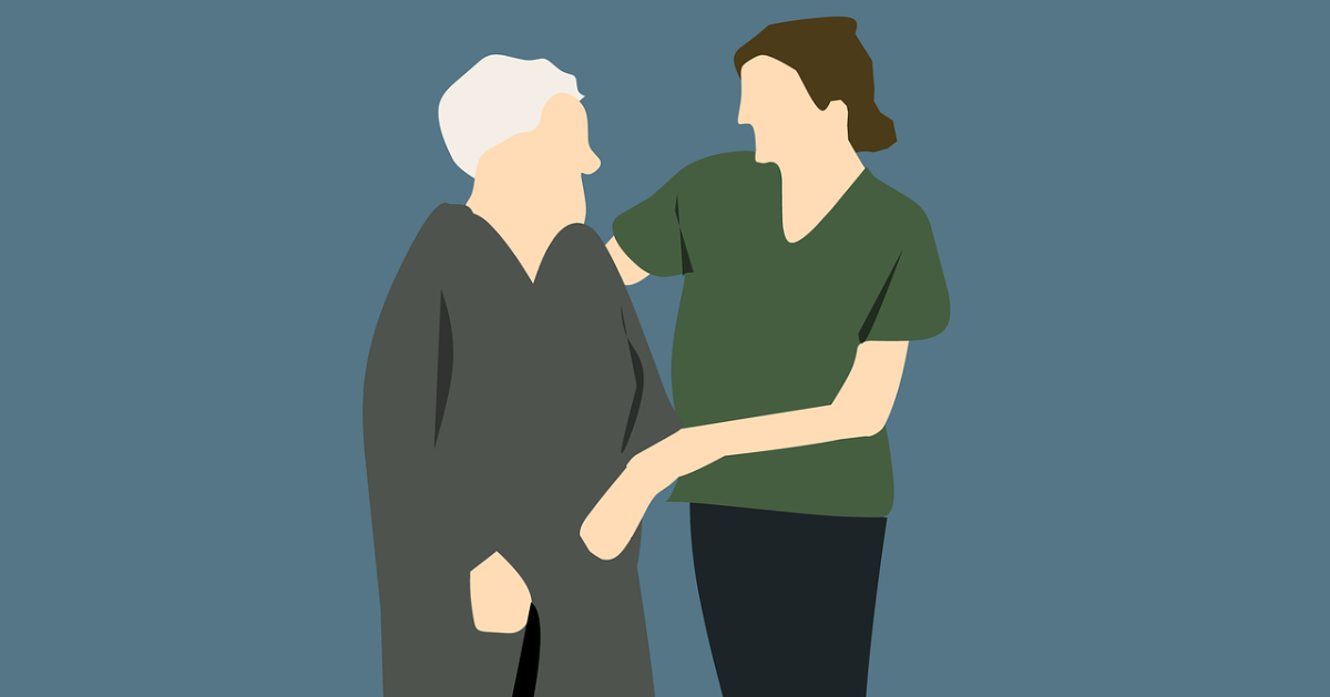 A nurse helping a senior