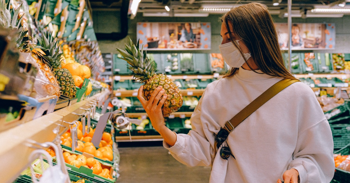 Woman wearing a mask while grocery shopping