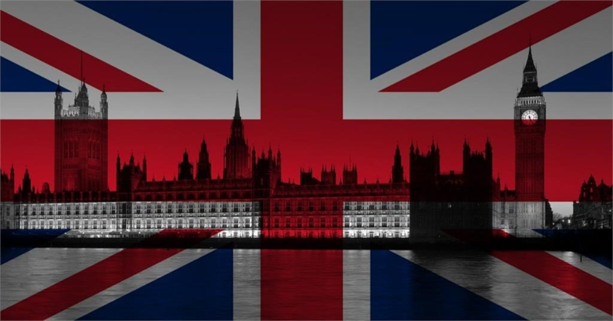 The British Parliament with the Union Jack in the background.