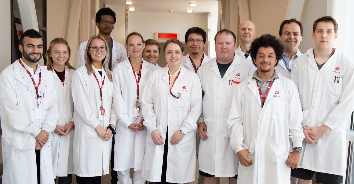 Dr. Emilio Alarcon posing with his team from the BEaTS Research Lab