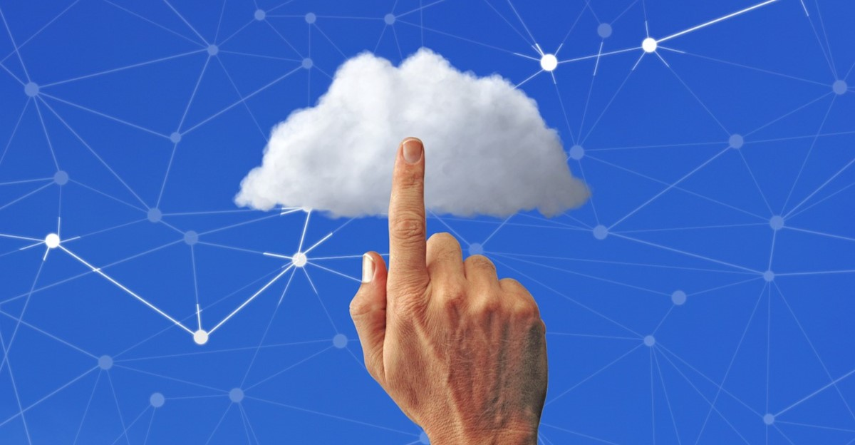 Extended finger pointing to a cloud