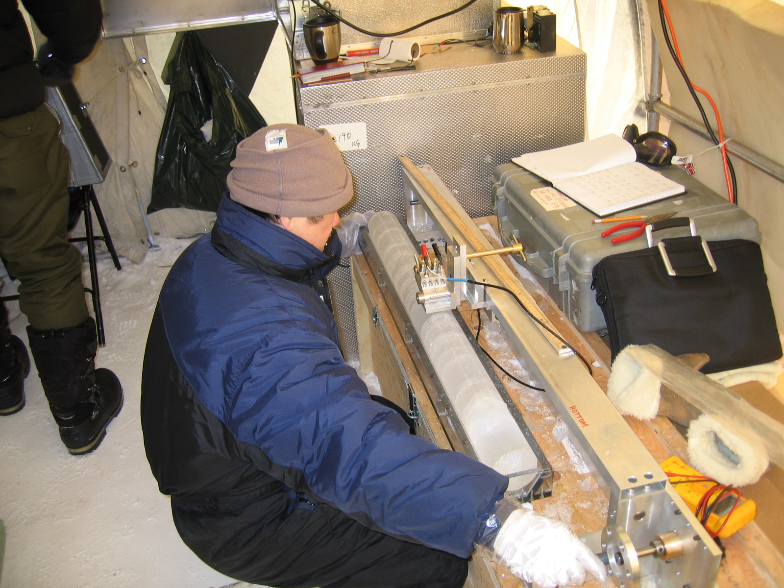 A scientist measures an ice core