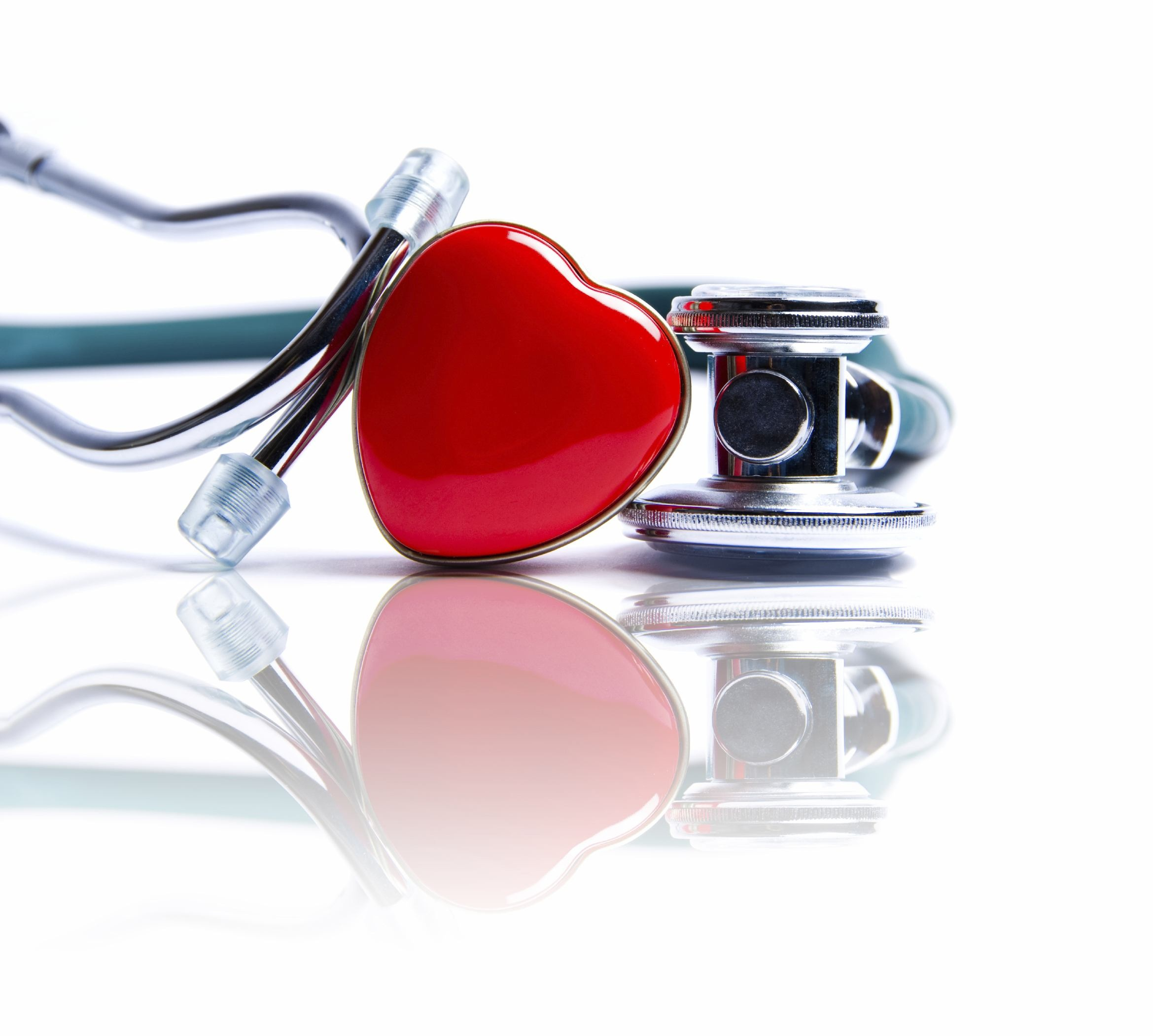 Stethoscope on a table with a red heart