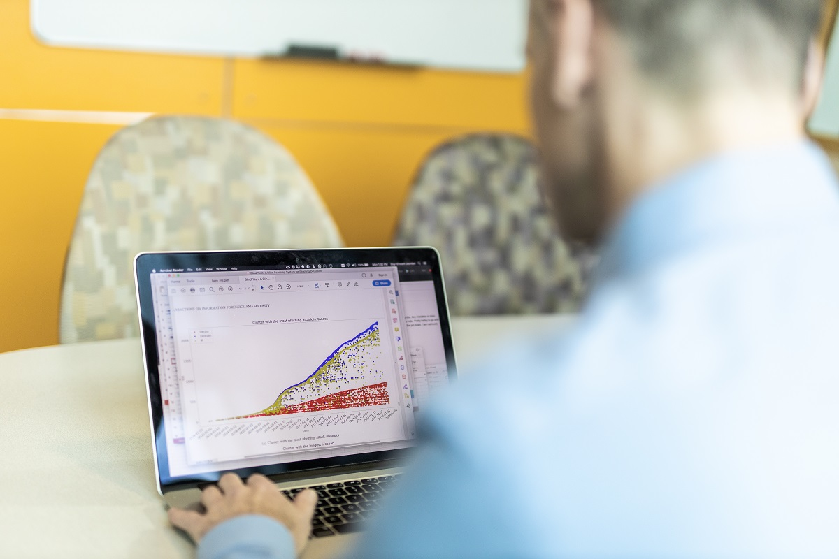 Back view of Professor Guy-Vincent Jourdan using a computer